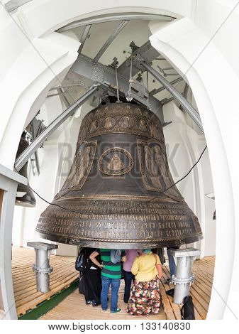 Sergiyev Posad Russia - June 21, 2015: Group of tourists visits the Tsar Bell the largest and heaviest bell acting in the Christian world on the bell tower of the Trinity-Sergius Lavra in Sergiyev Posad Russia.