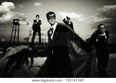Multi-ethnic Superhero Businessmen Concept