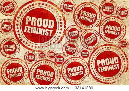 proud feminist, red stamp on a grunge paper texture