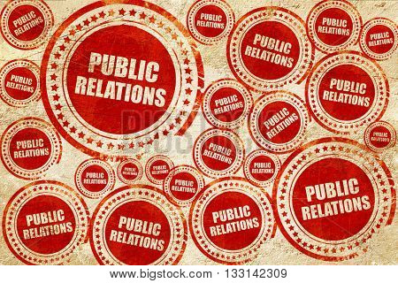 public relations, red stamp on a grunge paper texture