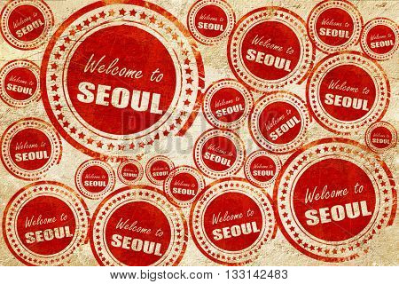 Welcome to seoul, red stamp on a grunge paper texture