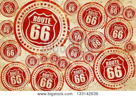 Route 66 sign, red stamp on a grunge paper texture