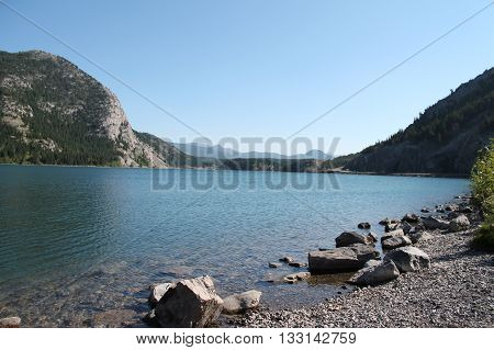 beautiful lake amidst mountains with clear water