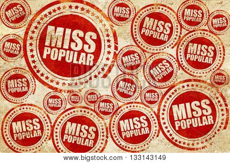 miss popular, red stamp on a grunge paper texture