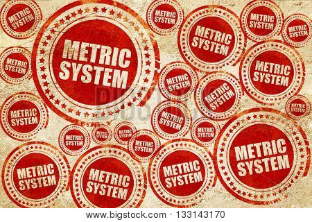 metric system, red stamp on a grunge paper texture