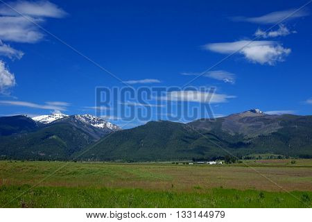 The Bitterroot Mountains provide a beautiful background for ranches in Montana.