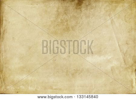Aging stained paper background. Natural old paper texture for the dsign.