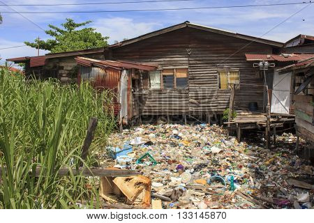 KOTA KINABALU, MALAYSIA - 05 JUNE 2016: Poor asian village with pollution problem. Plastic bottles, bags and sewerage dropped directly into ocean.