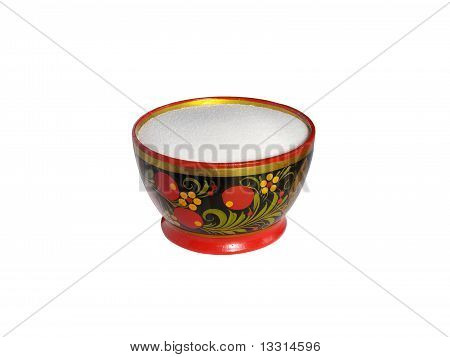 Wooden painted saltcellar with salt isolated on white background