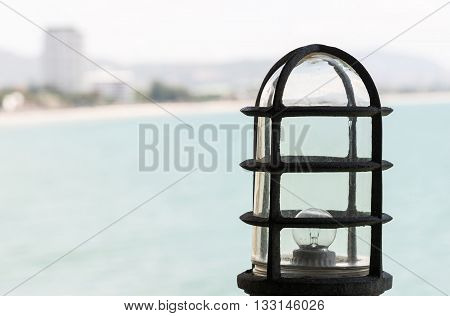 Old metal lamp of the viewpoint on the high mountain near the sea.