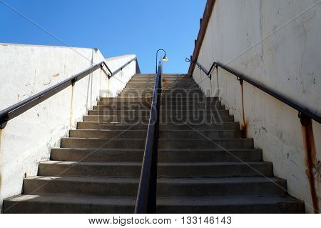 A stairway leads to a platform from which passengers may ride trains at the Joliet Union Station in Joliet, Illinois.