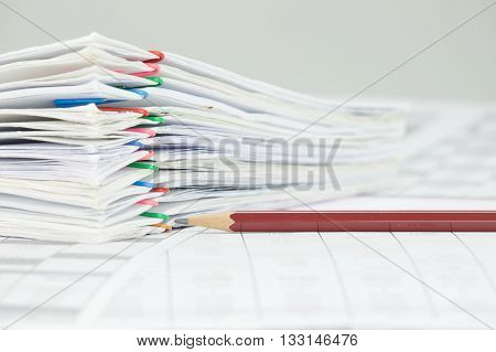Brown Pencil And Overload Of Paperwork On White Background