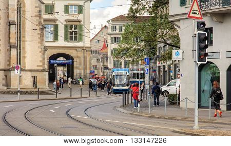 Zurich Switzerland - 4 September 2015: trams and pedestrians on the Limmatquai quay at the morning. Zurich is the largest city in Switzerland and the capital of the Swiss canton of Zurich.