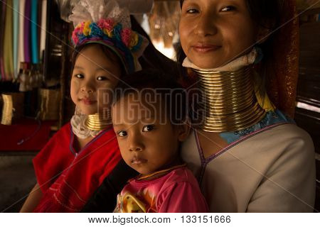 CHIANG MAI, TAILAND - APRIL 22, 2016: A portrait of a family from Kayan Lahwi tribe known for wearing neck rings, brass coils to extend the neck. Kayan, Red Karen (Karenni).