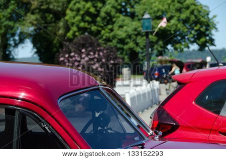 Red pillars of an old and new cars in Port Gamble, Washington