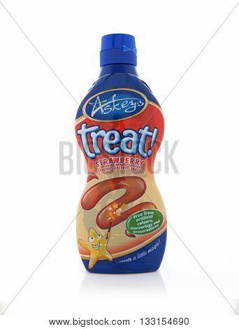 SWINDON UK - JUNE 3 2016: Bottle of Askeys Treat Desert Strawberry Sauce on a white background