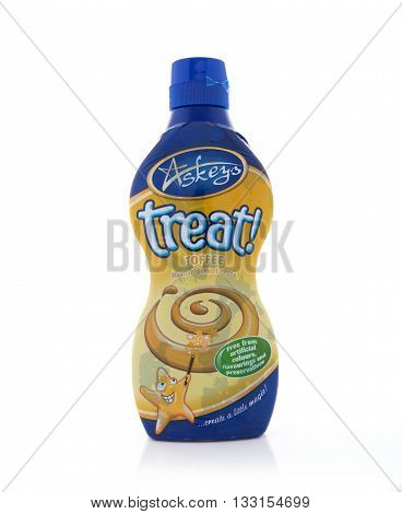 SWINDON UK - JUNE 3 2016: Bottle of Askeys Treat Desert Toffee Sauce on a white background