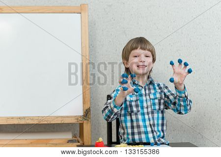 Boy Sculpts From Plasticine At Home