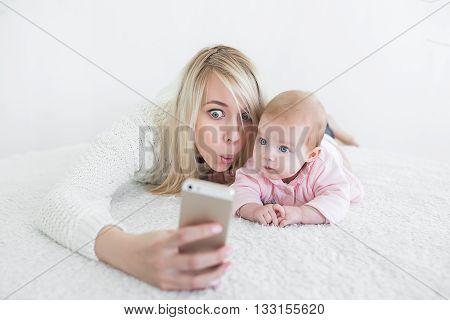 Baby Make Selfie On Mobile Phone