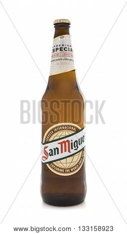 SWINDON UK - MARCH 30 2016: Bottle of San Miguel Beer on a white background The original San Miguel Brewery was founded in 1890 in Philippines.