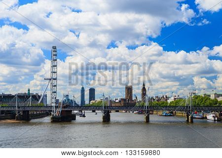 LONDON UNITED KINGDOM - 23 MAY 2016: London Eye is the tallest Ferris wheel in Europe Big Ben and Westminster Abbey in London United Kingdom