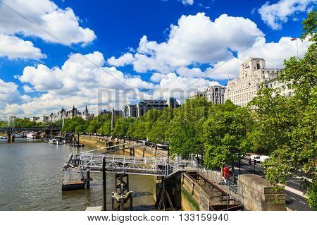 LONDON UNITED KINGDOM - 23 MAY 2016: Sunny day along the river Thames in London United Kingdom. This is one of the most popular places to visit in UK.