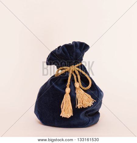 The blue velvet pouch with gold tassels