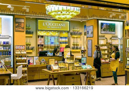 Moscow, Russia - March 29, 2016: Saleswoman in a corporate yellow interior of boutique