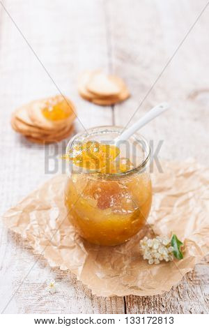 Fresh fruity juicy jam with figs in a jar with crackers and cottage cheese for breakfast closeup with copy space