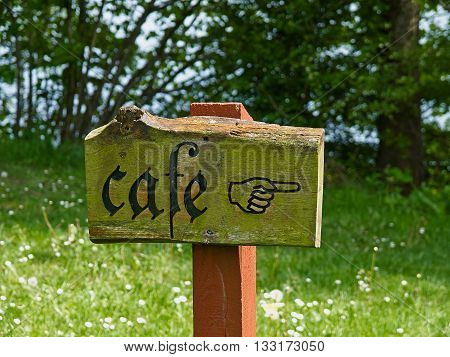 Rustic country style sign of a cafe coffee shop out in nature