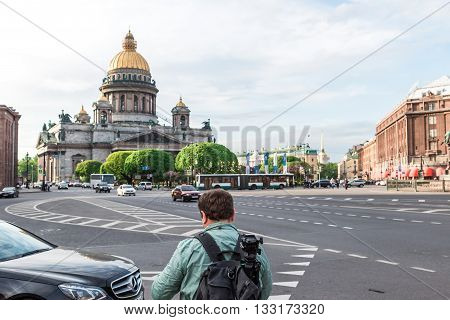 St.Petersburg Russia - May 16 2016: St.Isaak's square. A man with video making equipment.
