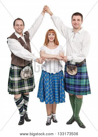 Three dancers in clothing for Scottish dance isolated