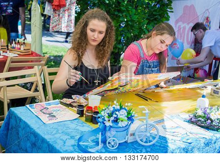 Zaporizhia/Ukraine- June 5, 2016: girls on painting workshop  during charity family festival organized in regions with most quantity of refugees from Donetsk area, occasioned with International Children`s Day
