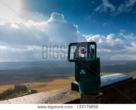 spyglass on viewing platform against sky .