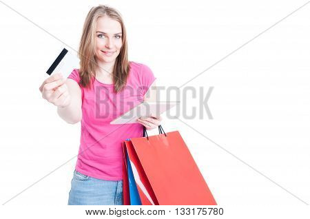 Happy Woman Holding Tablet With Shopping Bags Offering Debit Card