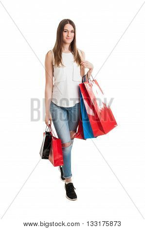 Full Body Of Attractive Young Shopaholic Holding Many Shopping Bags