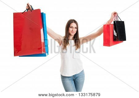 Lovely Joyful Girl Smiling And Rising Up Colored Shopping Bags
