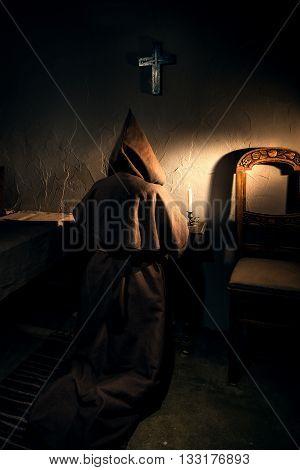 Ancient monk prisoner in dark castle prison