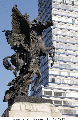 Pegasus sculpture in front of the Latin American tower and Palacio de Bellas Artes in Mexico City Mexico