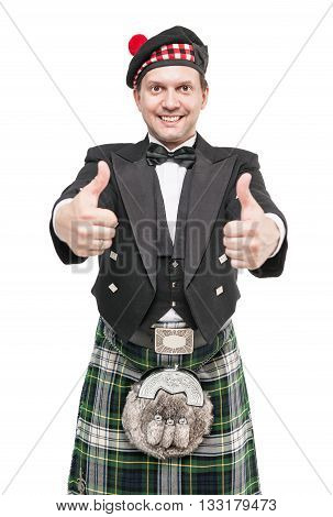 Young Man In Clothing For Scottish Dance Showing Thumbs Up