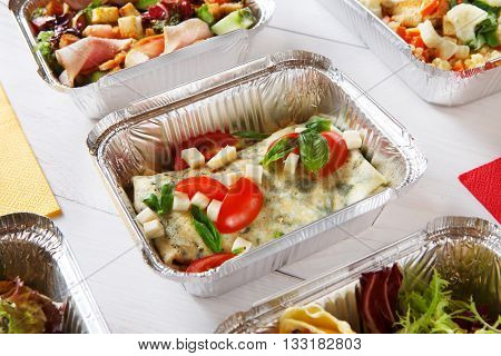 Healthy eating, diet concept. Healthy lunch, Take away organic food. Weight loss diet, food take away in aluminium boxes. Healthy food background. Vegetables and french crepe with cheese at white wood