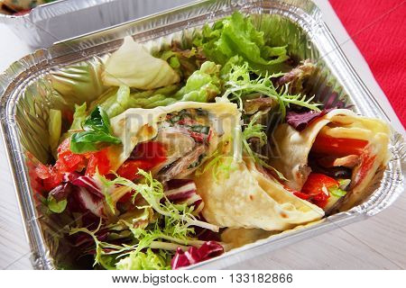 Healthy lunch. Fitness food. Weight loss nutrition diet, low carb food take away in aluminium container. Healthy food background. Vegetable salad with crepe closeup at white wooden table
