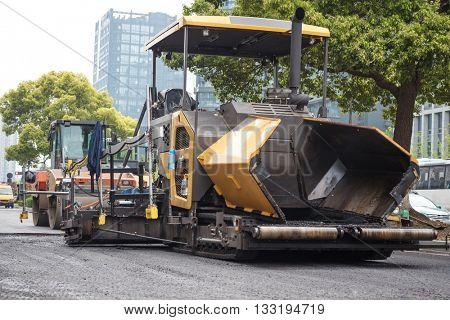 asphalt pavement roller on road