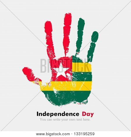Hand print, which bears the Flag of Togo. Independence Day. Grunge style. Grungy hand print with the flag. Hand print and five fingers. Used as an icon, card, greeting, printed materials.