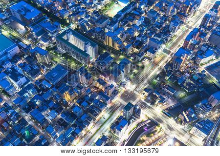 building with blue roof in residential district of tokyo
