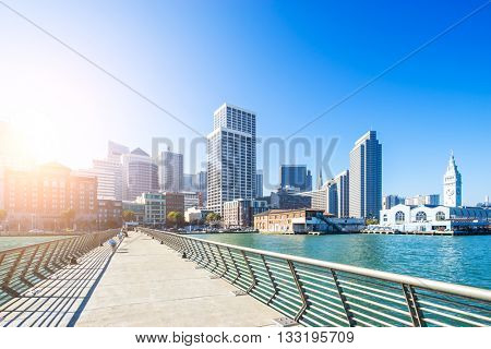 empty footpath on bridge with cityscape and skyline of portland