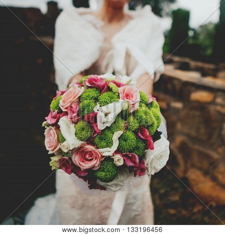 Beautiful wedding bouquet in the bride's hands.