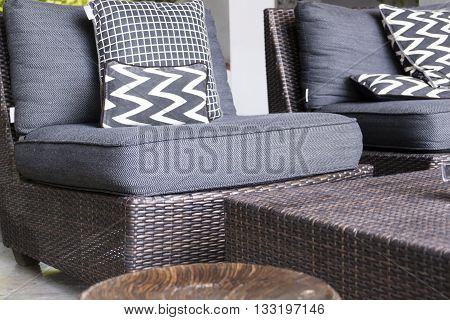 Black, White Cushion And Pillow On Wicker Chair