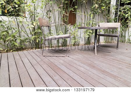 Wooden Desk And Chair On Patio