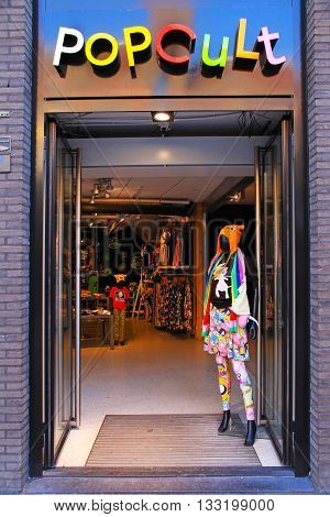 AMSTERDAM, THE NETHERLANDS - MAY 3, 2016: Pop Cult fashion store on the Damrak main street in Amsterdam, Netherlands.